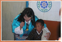 H.M. Queen Tshering Pem with blind child